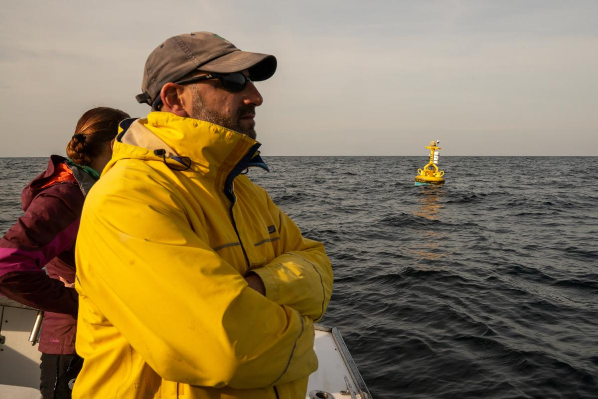 Howard Rosenbaum, from the Wildlife Conservation Society, keeps an eye out for whales – while a special high-tech buoy 'listens' for their calls.