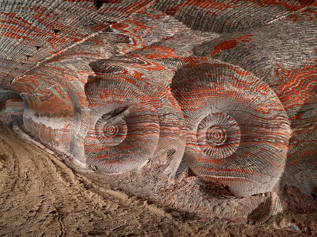 An underground potash mine in the Ural mountains of Russia. The potassium-rich salt is mined to produce fertilizer. The team says that the mine shows the impact of modernized agricultural practices that help feed Earth's 7.5 billion people. The spiraled p