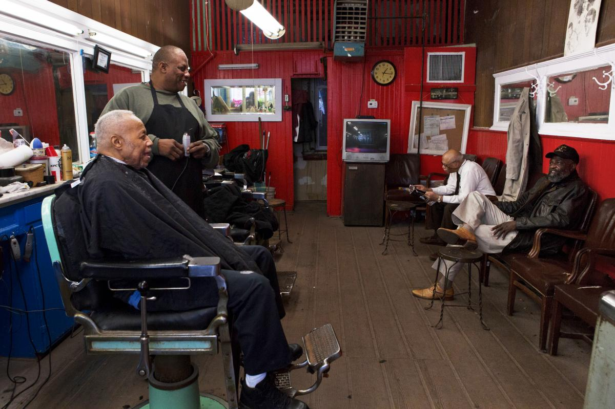 Petersen (right) visits Gregg's Barber Shop, which has been in the same location since 1913. Gennaro Ballard (center) says that the biggest change in Shaw has been the people. He has been a barber at Gregg's for 10 years.