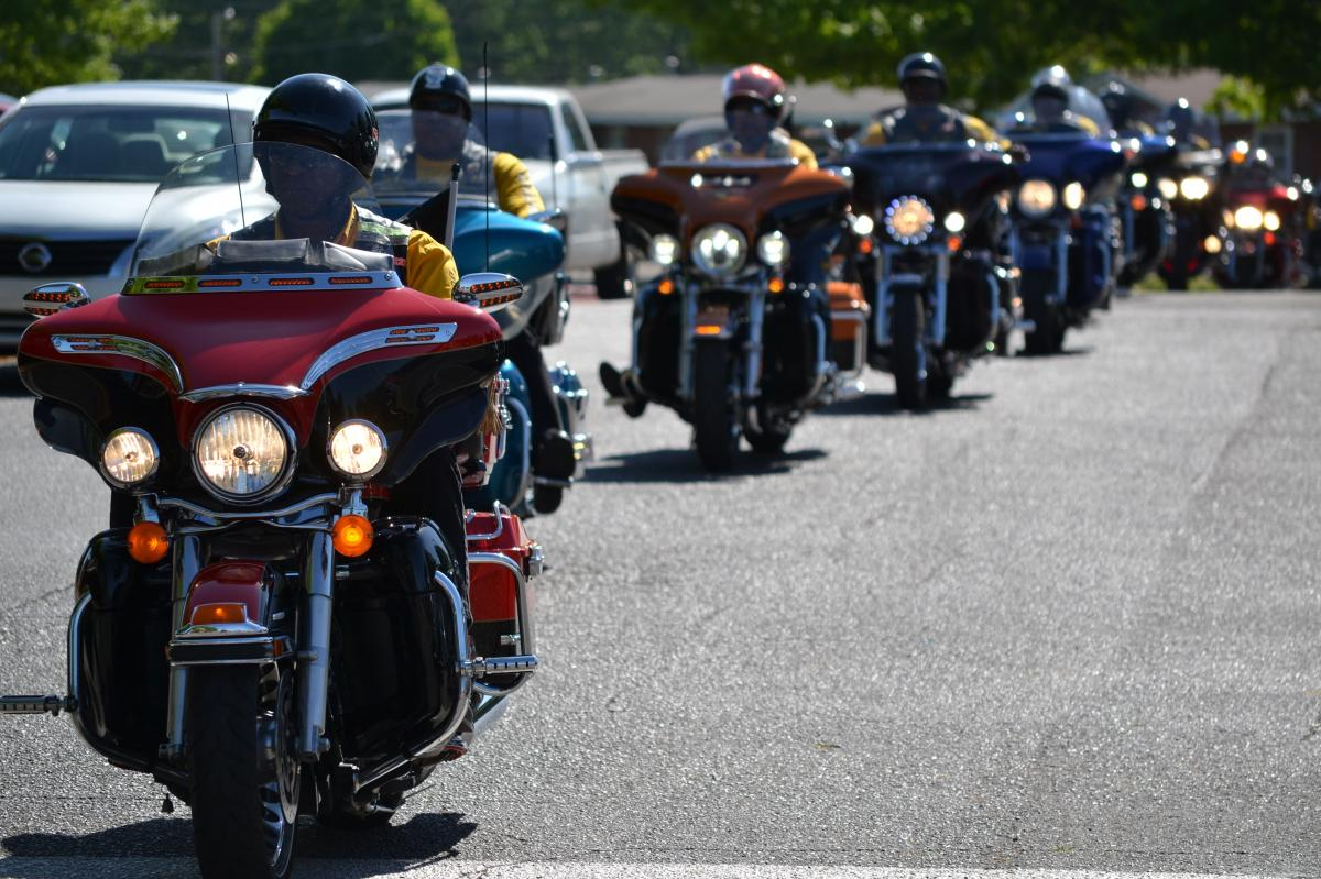 Members of the Buffalo Soldiers motorcycle club ride in Huntsville, Ala., on April 26, 2014. Together with the Huntsville Historical Society, the bikers were unveiling a Buffalo Soldier historical marker.