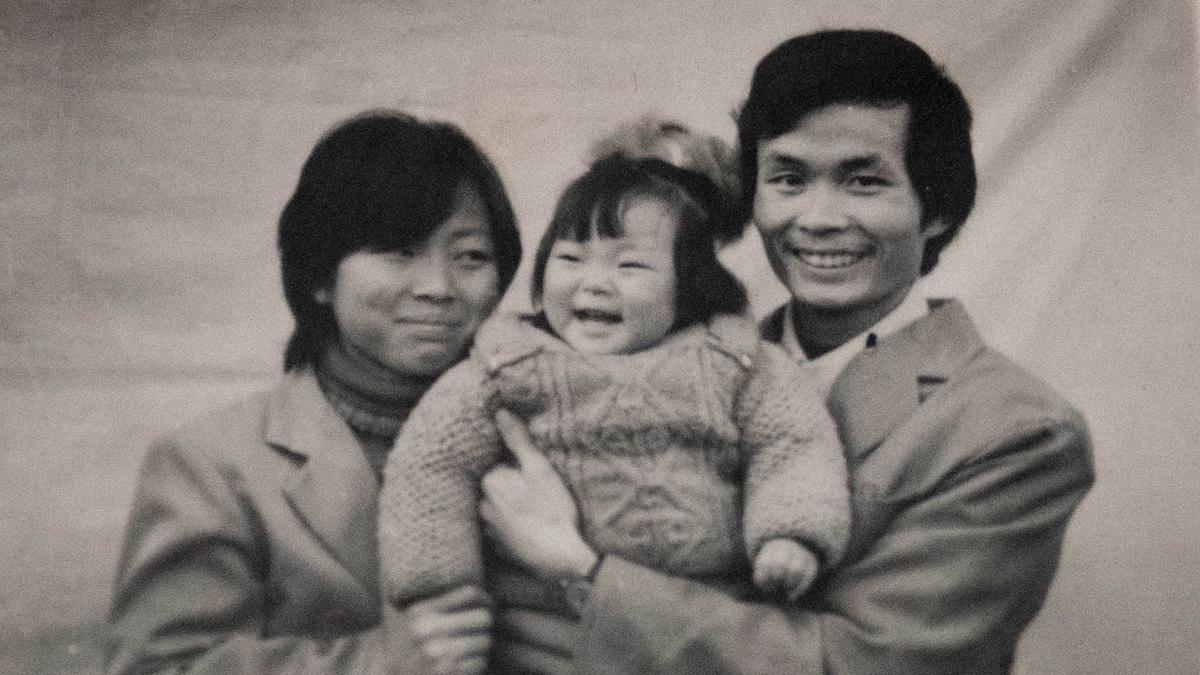 Director Nanfu Wang's One Child Nation documentary draws on her own family's experience with the restrictive policy. She's pictured here as a child with her parents.