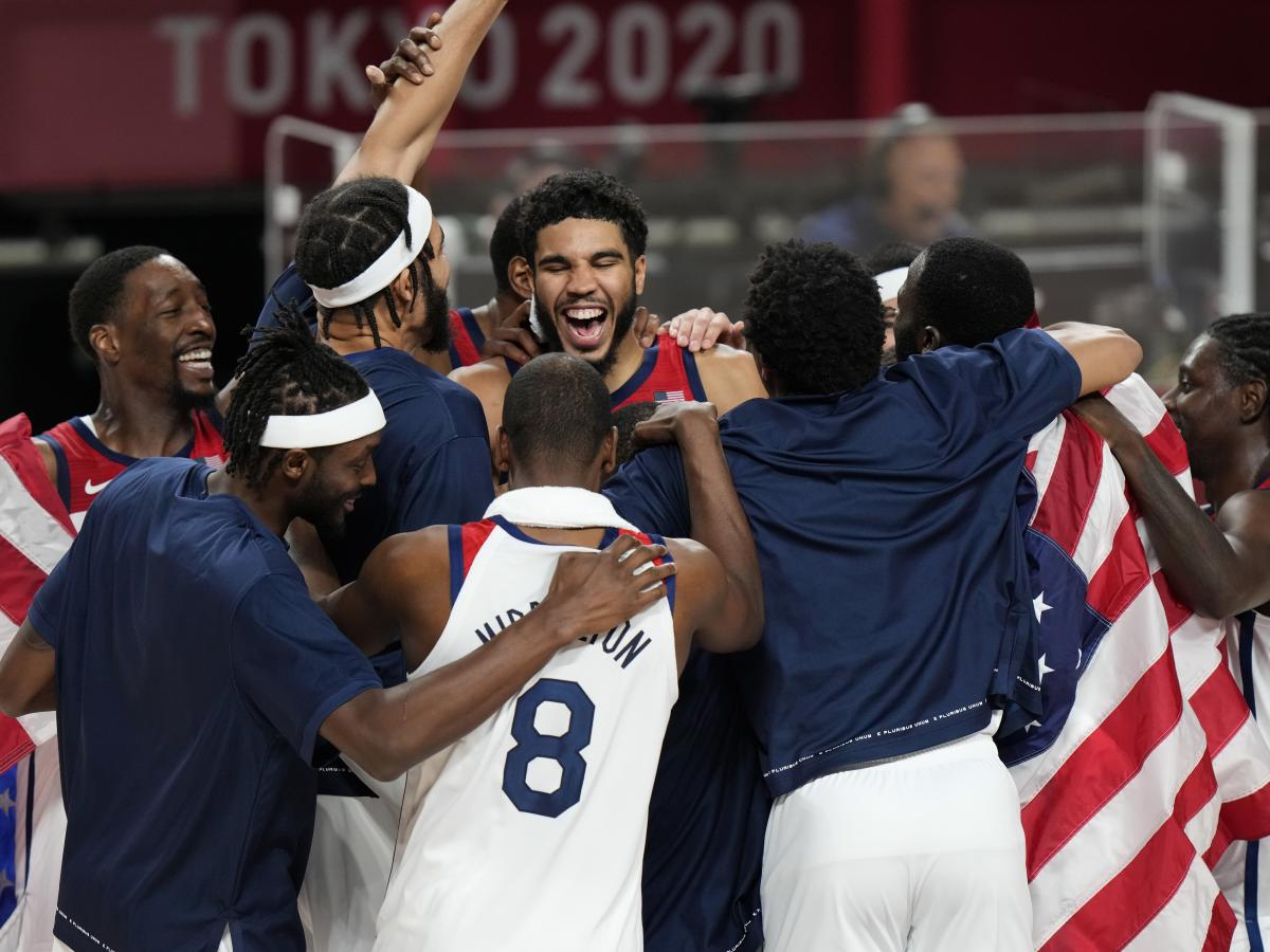 United States' players celebrate after their win in the men's basketball gold medal game against France at the 2020 Summer Olympics on Saturday.