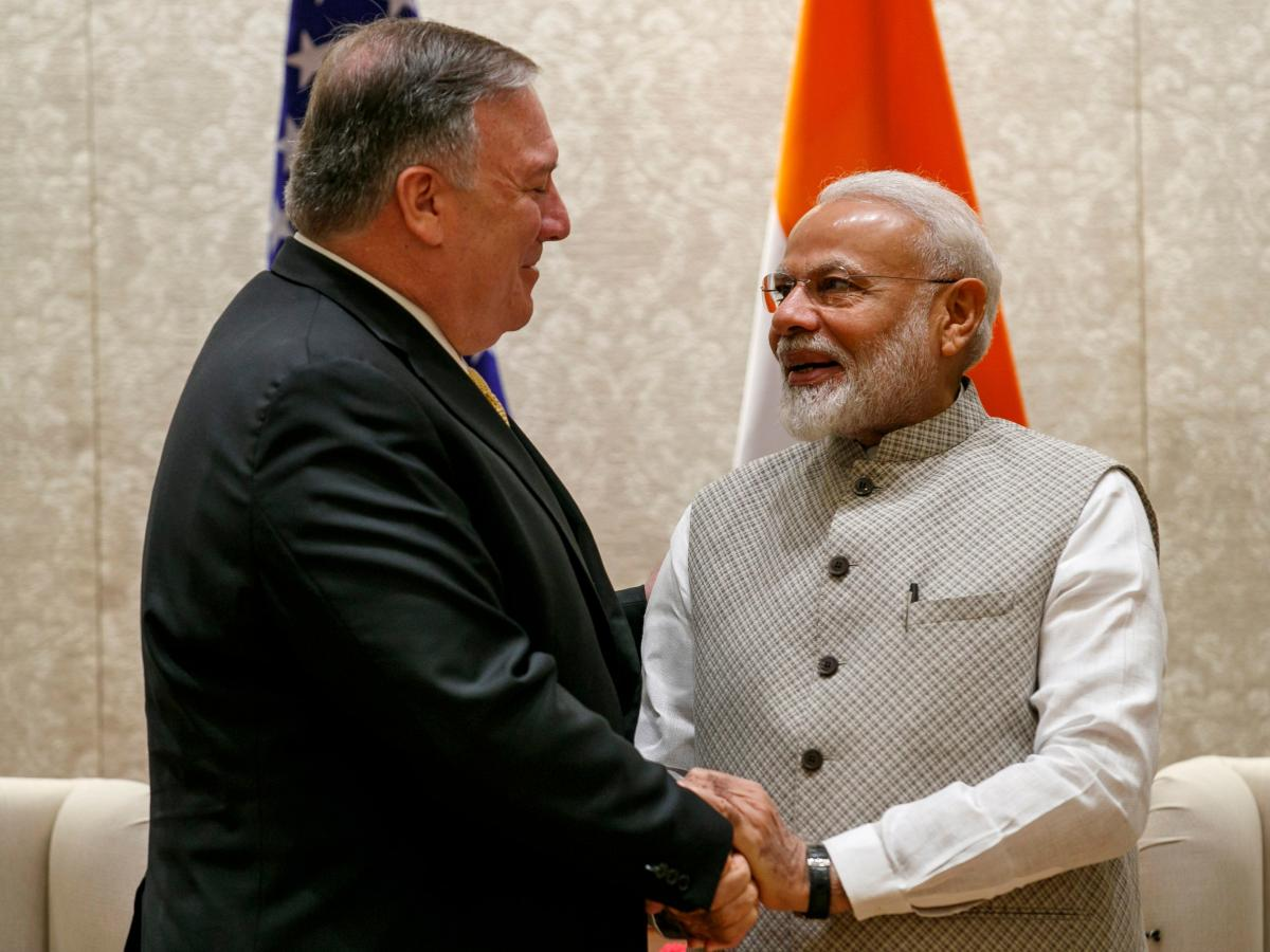 Secretary of State Mike Pompeo shakes hands with India's Prime Minister Narendra Modi during their meeting in New Delhi on June 26.