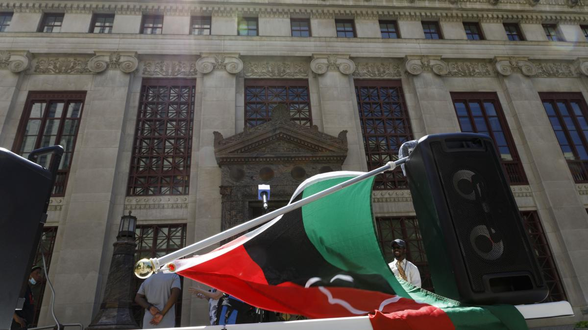A Pan-African flag is draped over speakers at a press conference about Juneteenth held by DaVante Goins in front of the Columbus, Ohio city hall on June 17, 2021.