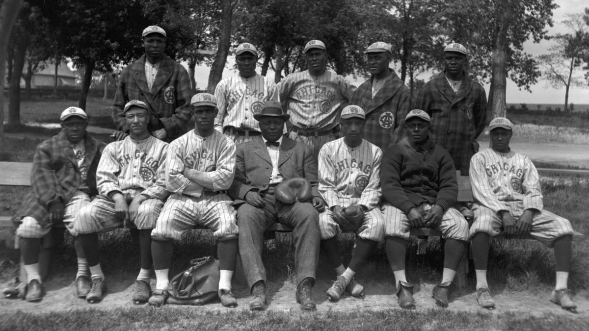 """Members of the Chicago American Giants pose for a team portrait in 1914 in Chicago. (L to R) (Front row) Billy """"Little Corporal"""" Francis, Richard """"Dick"""" Whitworth, Joseph Preston """"Pete"""" Hill, Andrew """"Rube"""" Foster, Bruce Petway, James """"Pete"""" Booker, uniden"""