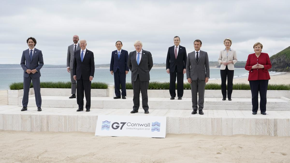 Leaders of the Group of Seven countries pose for a photo by the beach in Carbis Bay, in Cornwall, England, on June 11.