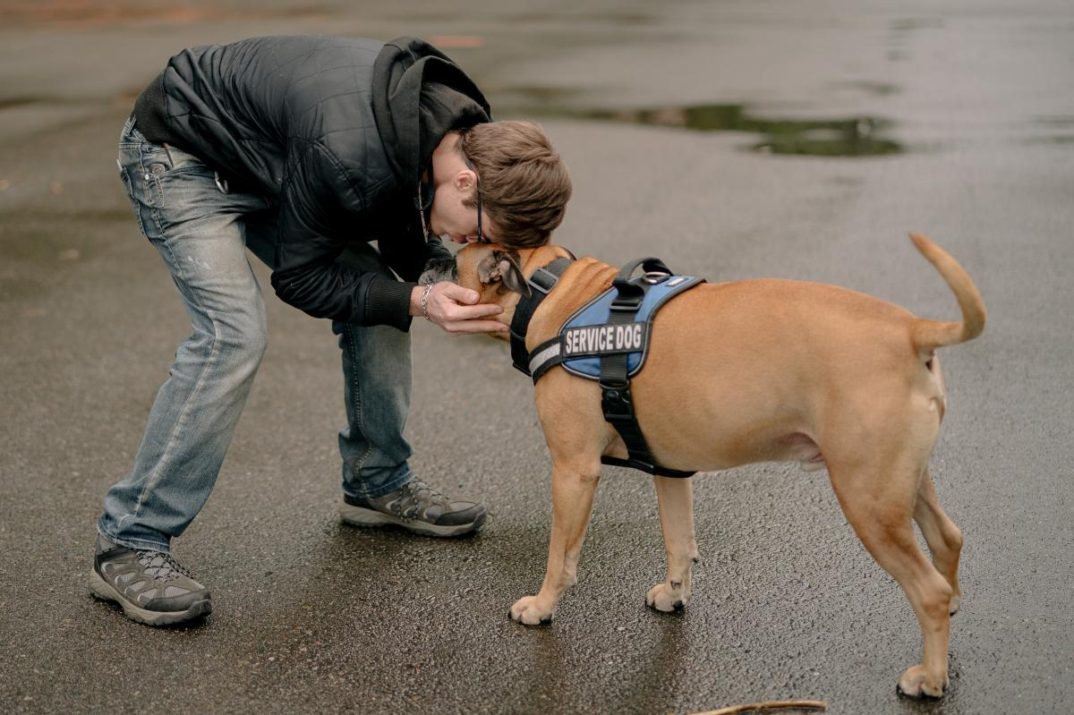 Harrison Schapelhouman with his service dog.