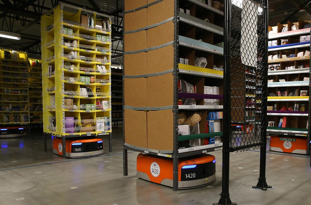 Kiva robots move racks of merchandise at an Amazon fulfillment center in Tracy, Calif., in 2015. The machines bring the shelves to workers.