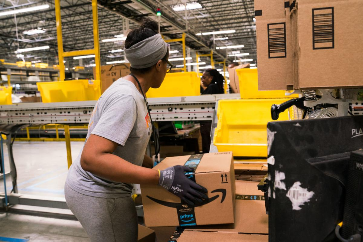 An employee works on an order in Amazon's fulfillment center in Baltimore. Amazon's forecasting team works on anticipating demand for everything sold by the company worldwide.