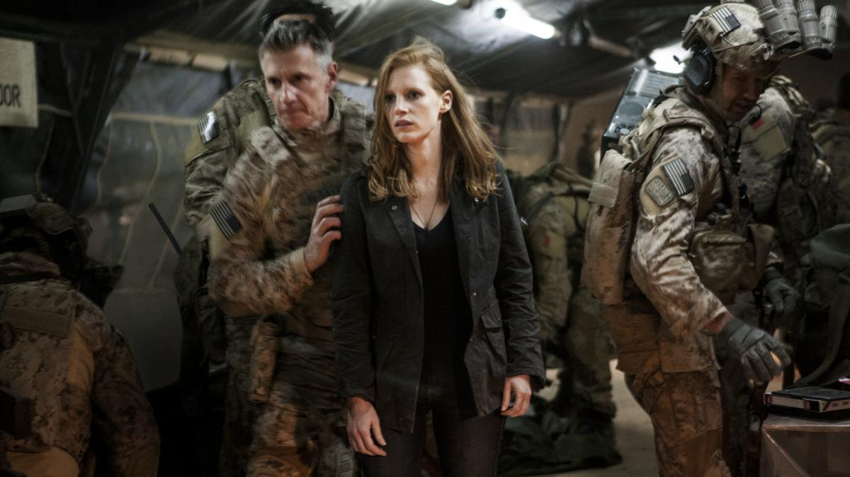 Stationed at a covert base overseas, Maya (Jessica Chastain) is a member of the elite team of spies and military operatives (Christopher Stanley, left, and Alex Corbet Burcher, right) who devote themselves to finding Osama bin Laden in Zero Dark Thirty.