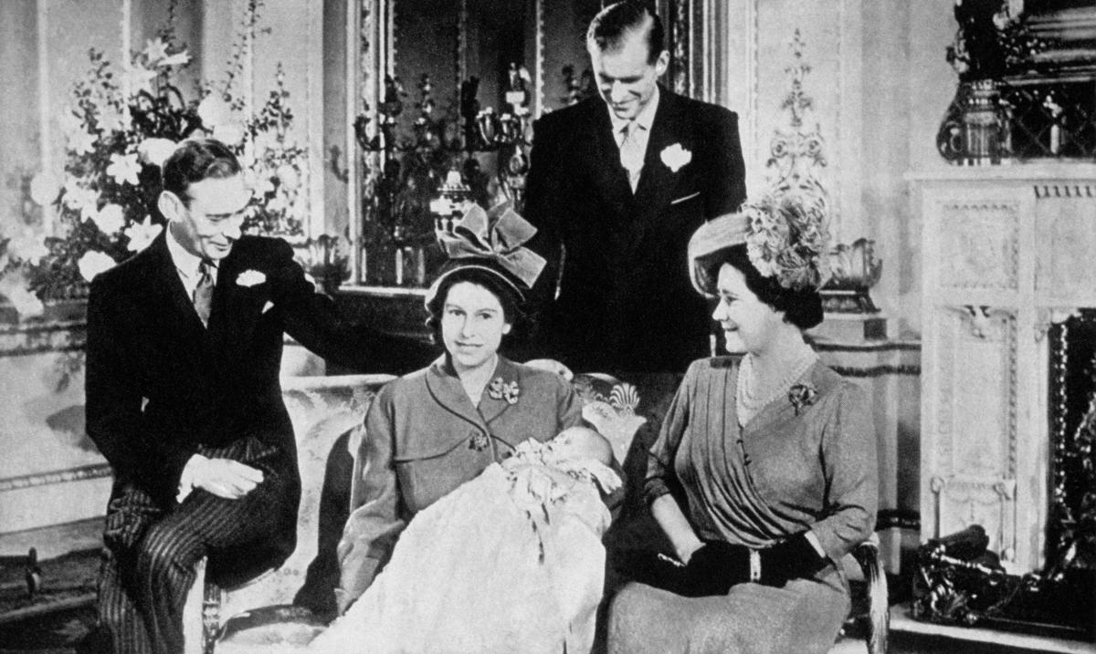 Then a princess, Elizabeth II holds her son Prince Charles while posing with her parents and husband. Charles was born on Nov. 14, 1948, and is the heir apparent to the British throne.