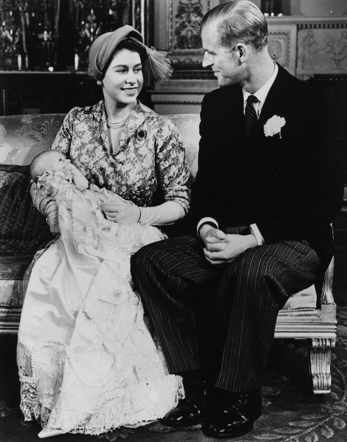 Elizabeth and Philip smile at each other after their daughter, Princess Anne, was christened in 1950. Elizabeth was not yet queen at the time.