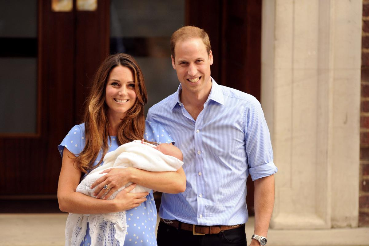 The Duke and Duchess of Cambridge, Prince William and the former Kate Middleton, smile while she holds their first child, Prince George, in 2013.