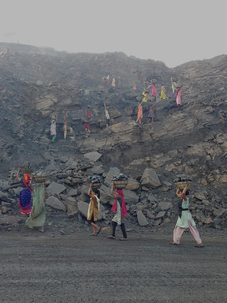 The dignified-looking procession is actually a line of coal thieves at a mine in Jharia, India, snatching chunks early in the morning before officials arrive.