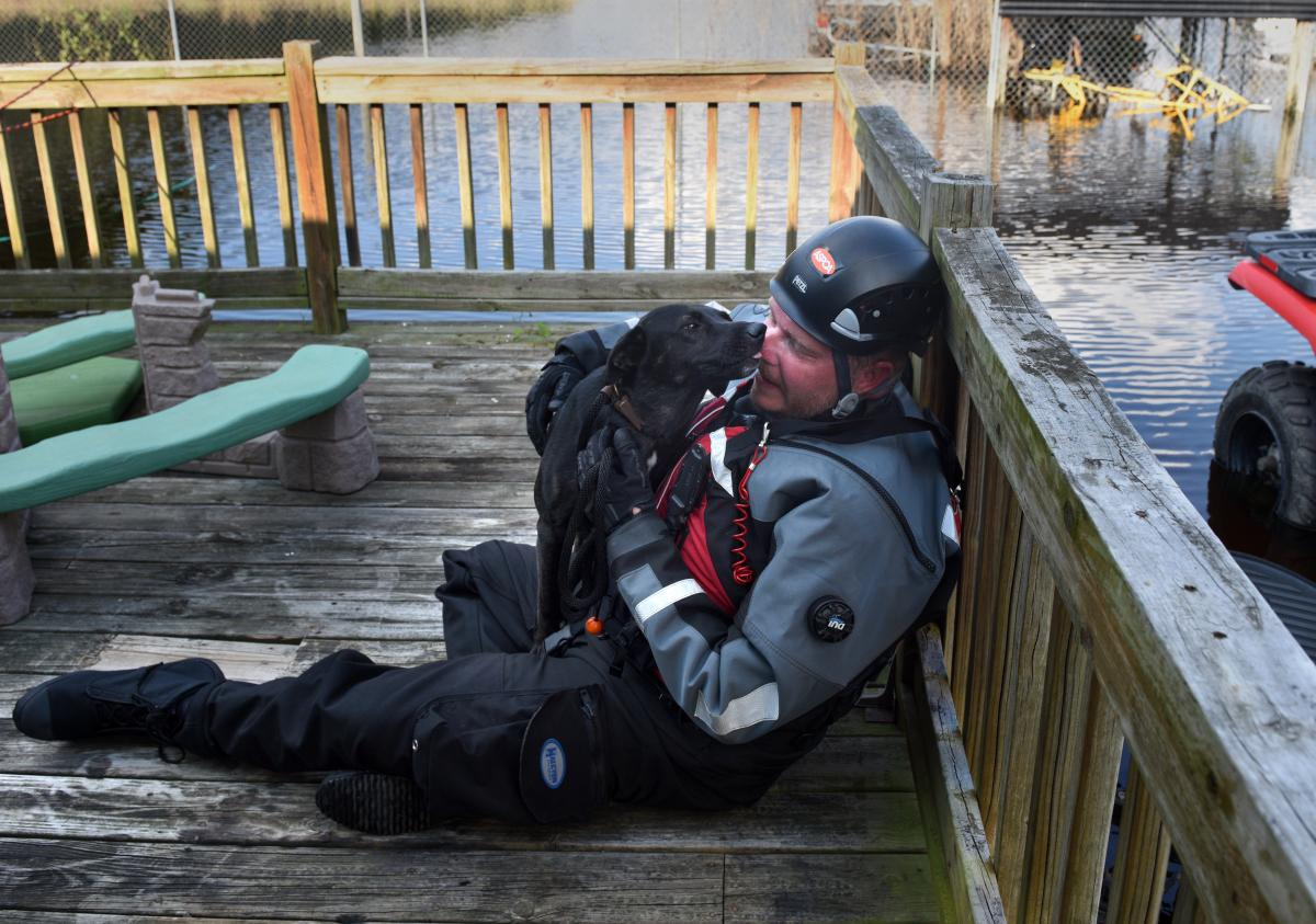 """Leath has become known among fellow rescuers as the """"dog whisperer"""" because of his skill at comforting frightened canines."""