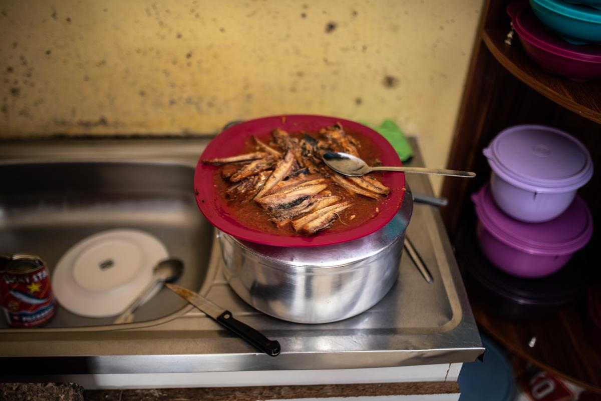 A plate of sardines in the kitchen. Maphini and her family have been relying on cheap proteins to supplement their meals.