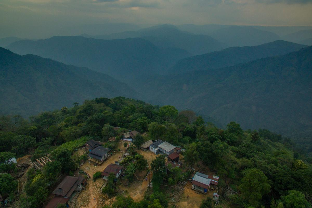A village stands on the edge of a mountain in the state of Meghalaya, India. Most of these villages are located on hilltops to avoid being washed away during monsoon season.