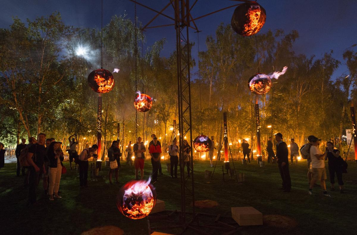 Fire Garden — part of the London's Burning festival — transformed the front lawn of the Tate Modern in London into a crackling, after-dark adventure made from burning structures, cascading candles and flickering flowerpots. The installation is shown a