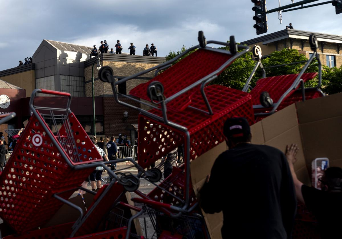 Protesters use shopping carts as a barricade as they confront police near the 3rd Police Precinct on May 27, 2020 in Minneapolis, Minnesota.