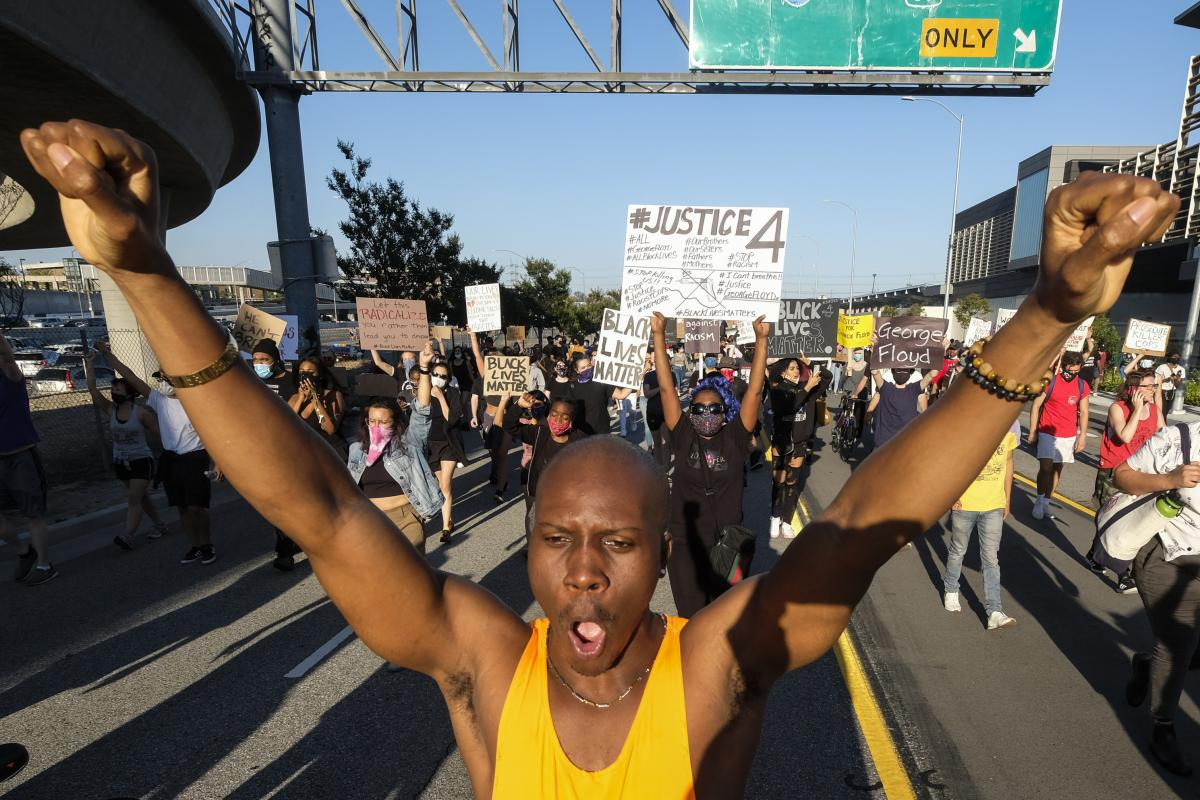 Demonstrators march during a protest of the death of George Floyd, a black man who was in police custody in Minneapolis, in downtown Los Angeles.