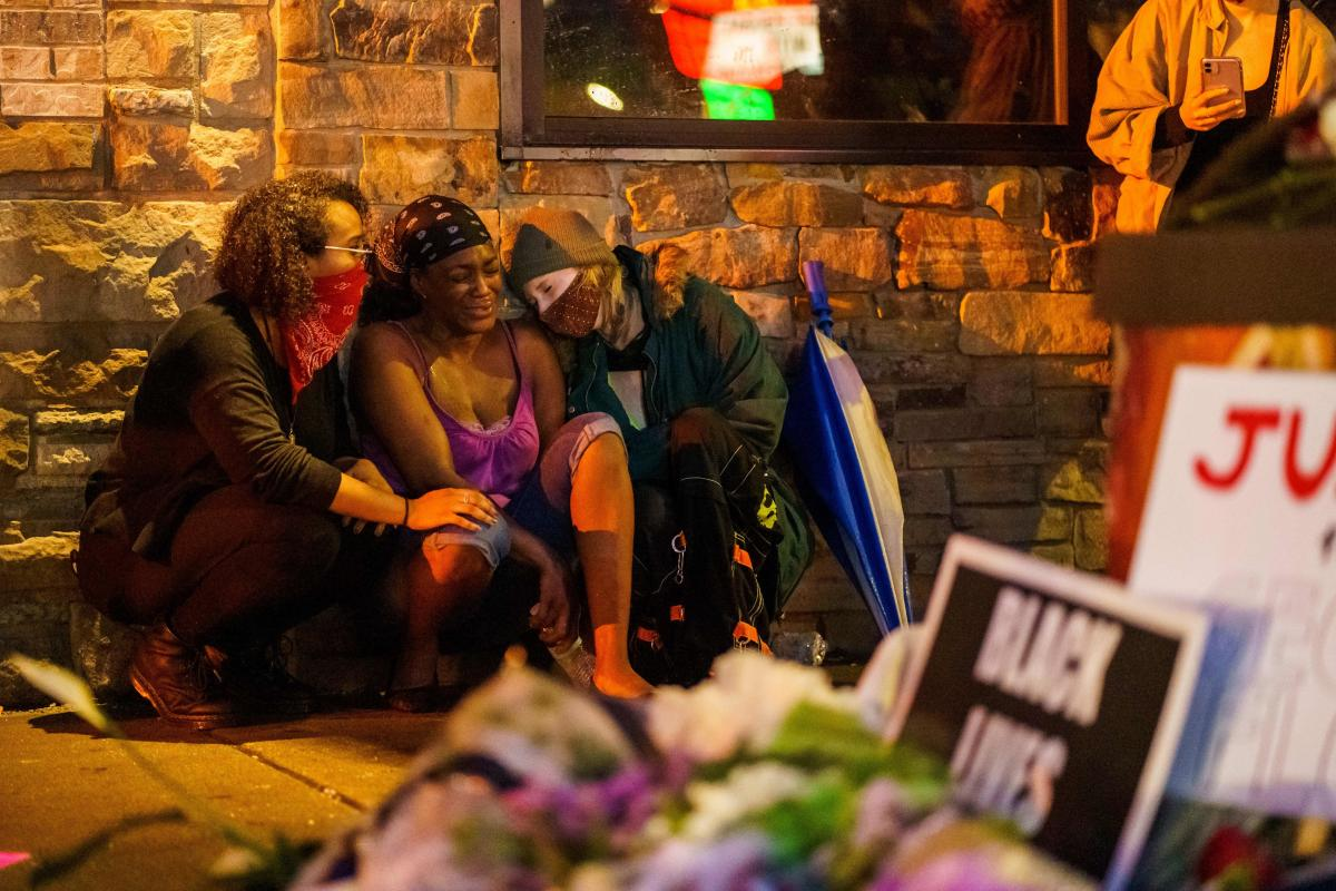 Shawanda Hill (C), the girlfriend of George Floyd reacts near the spot where he died while in custody of the Minneapolis Police, on May 26, 2020 in Minneapolis, Minnesota.