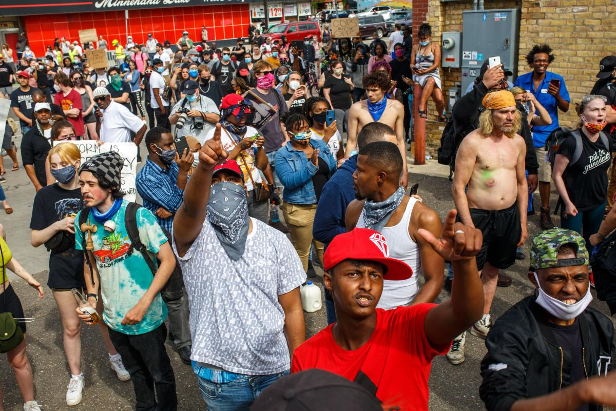 Protesters call for justice for George Floyd following his death, outside the 3rd Police Precinct on May 27, 2020 in Minneapolis, Minnesota.