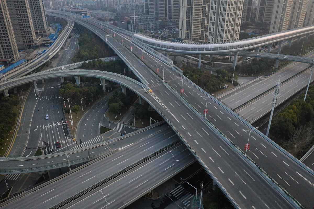 Roads are empty in Wuhan, where public transit has been shut down and residents are restricted in their excursions.