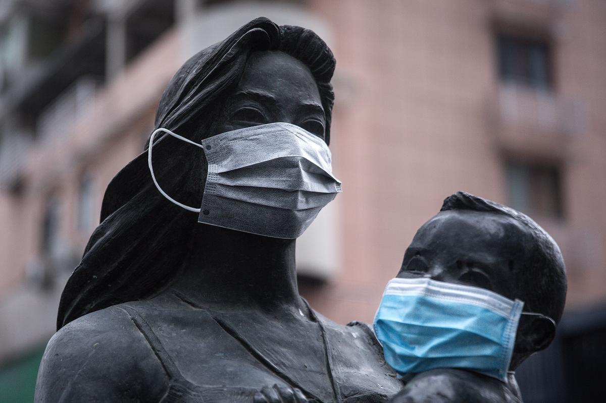 A sense of humor is still evident in Wuhan, where masks were affixed to the faces of a statue of a mother and her child.