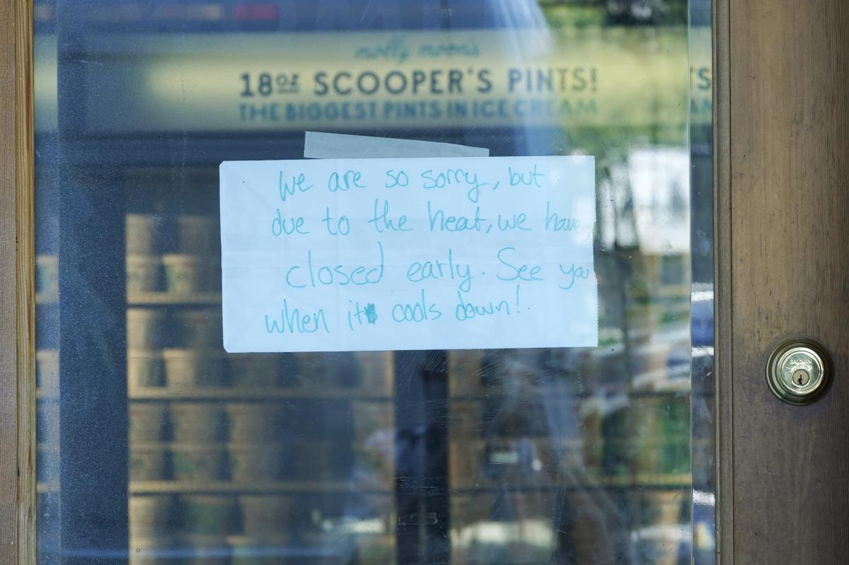 A sign is shown on the door of a Molly Moon's Ice Cream store in Seattle's Capitol Hill neighborhood. The store was closed Monday due to excessive heat.