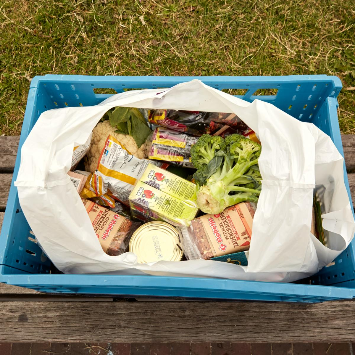"""A bag of groceries that Ottens got on her weekly pickup. """"I'd love to see more fruit and vegetables,"""" she says."""