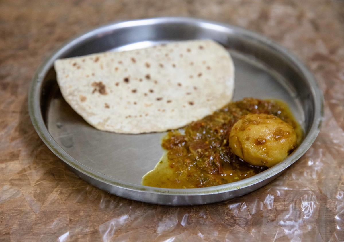 Salman's typical lunch: one piece of Indian bread and one curried potato.