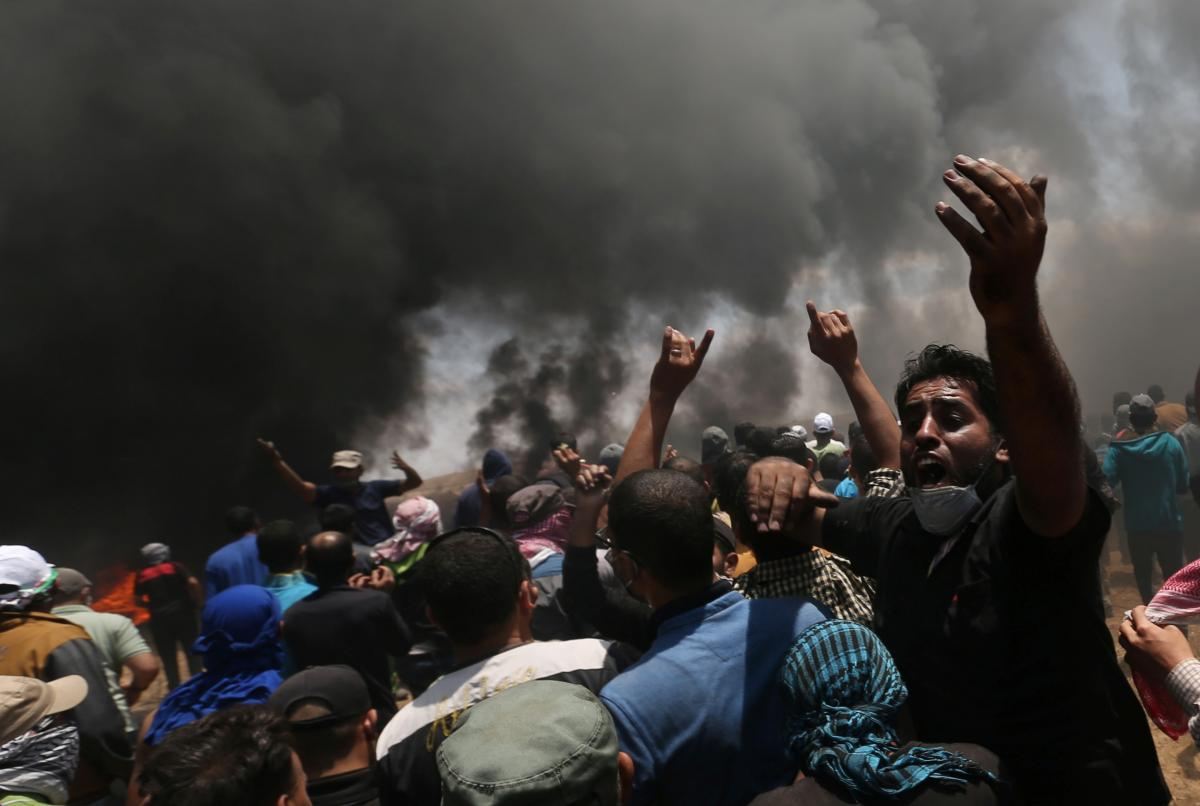 A Palestinian demonstrator protests against the U.S. Embassy move to Jerusalem at the Israel-Gaza border in the southern Gaza Strip on Monday.
