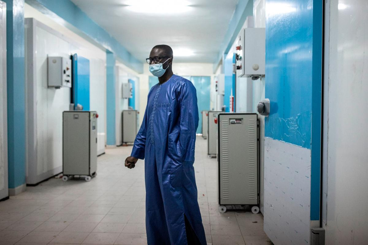 Ousseynou Badiane, the head of Senegal's vaccination program, stands in front of newly built cold rooms at Fann Hospital in Dakar, Senegal, in January. These cold rooms may be used to help store the country's stock of COVID-19 vaccines.