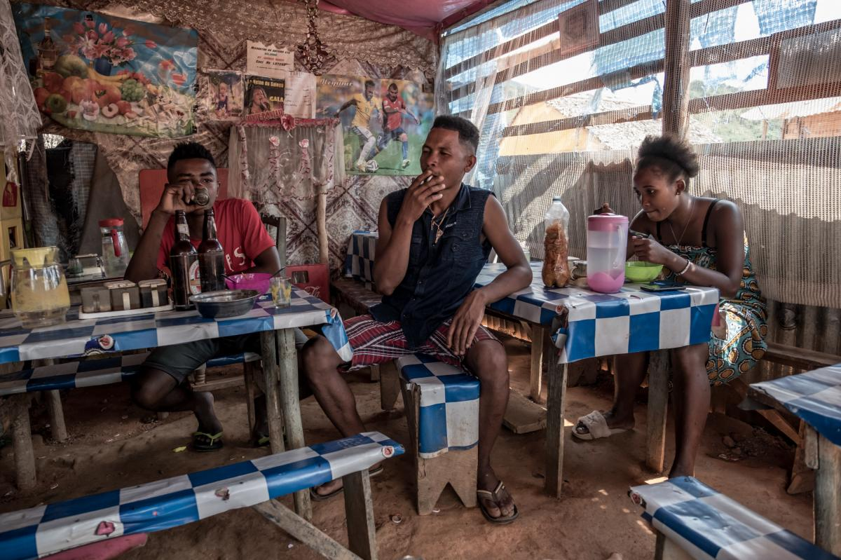 People eat lunch in a small restaurant owned by vanilla-farmer Beny Odon in Belambo, Madagascar.