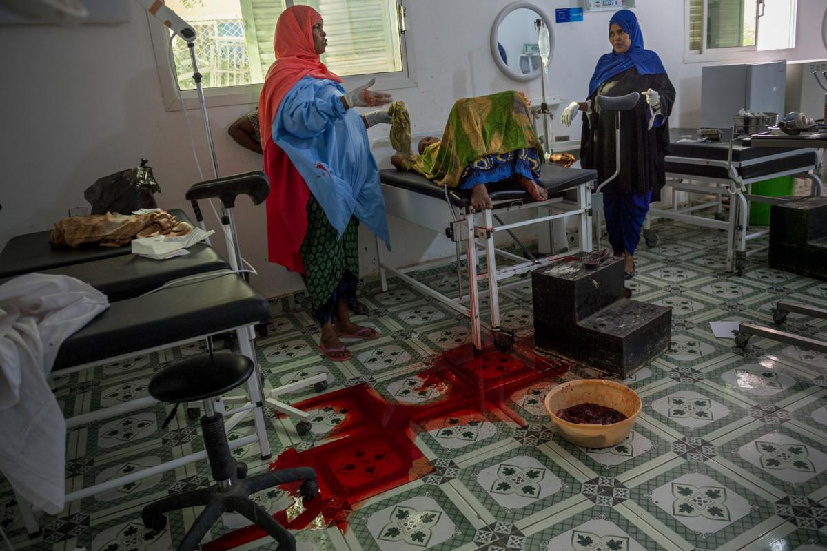 """A mother receives postnatal care in a Somaliland hospital. """"She was brought [there] in a wheelbarrow,"""" Addario recalls. """"She delivered her baby stillborn then started hemorrhaging. It was extraordinary for me to witness — it was very similar to what I'd"""