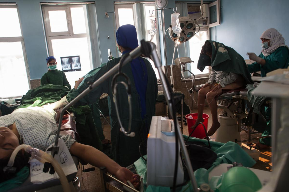 """""""This is a fistula repair in Kabul, Afghanistan, with two surgeries going on side by side,"""" Addario says. """"A fistula is a tear, often between the vagina and the anus. It's common in many countries with child marriage, or where women have birth very young."""