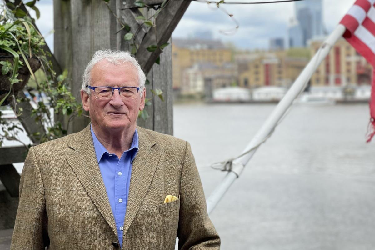 George Dailey, author of Great Pubs of London, stands on the deck of The Mayflower Pub. He says the reason pubs have such a cozy, lived-in feel is because they began in people's homes.