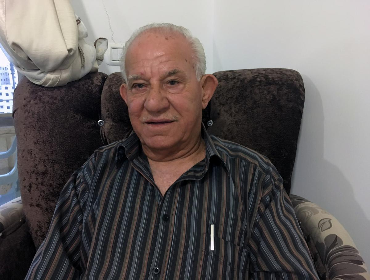 """Akram Tamimi, 79, moved to a neighborhood behind the barrier to maintain his Jerusalem residency rights, but calls it """"a prison."""""""