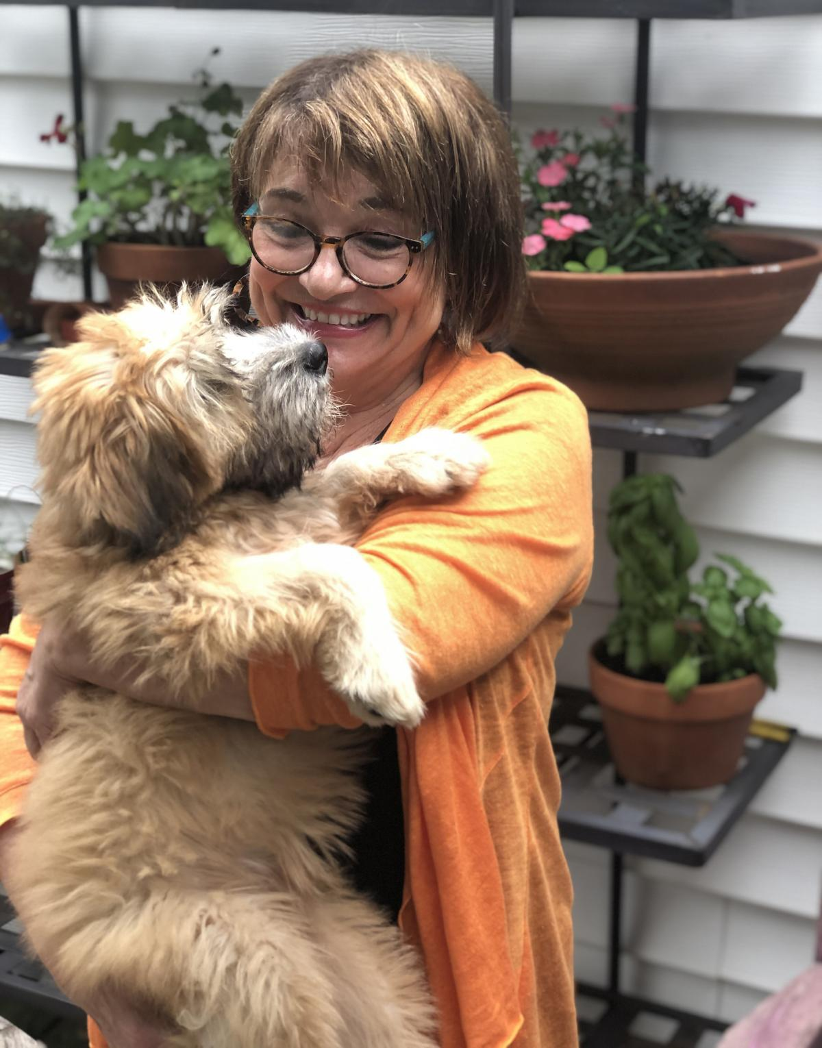 """Karen McCullough found a way to alleviate the loneliness that was starting to sink in. """"Rosie has been like this magnet; she's attracting me to people and it's good."""""""