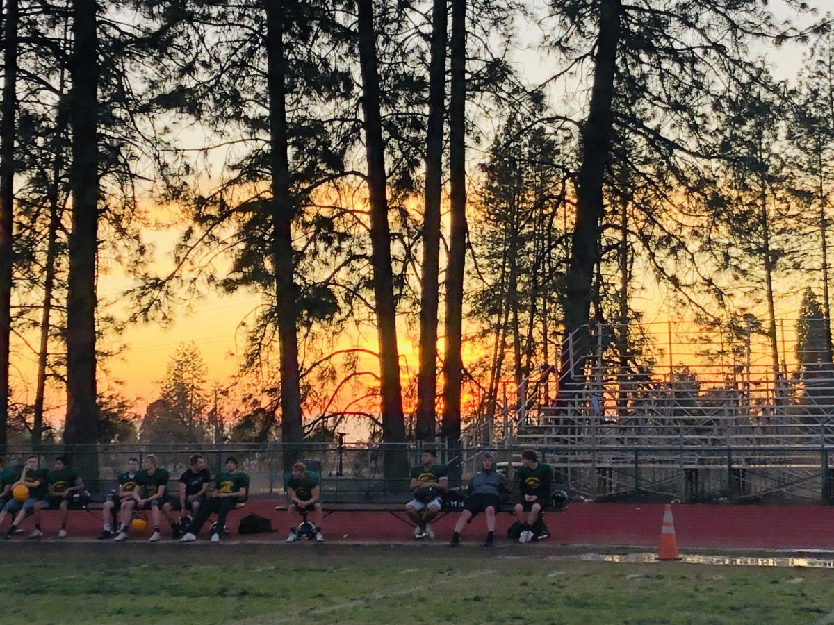 The wildfire damaged many of the school's portable classrooms, but spared the football field and surrounding sports buildings.