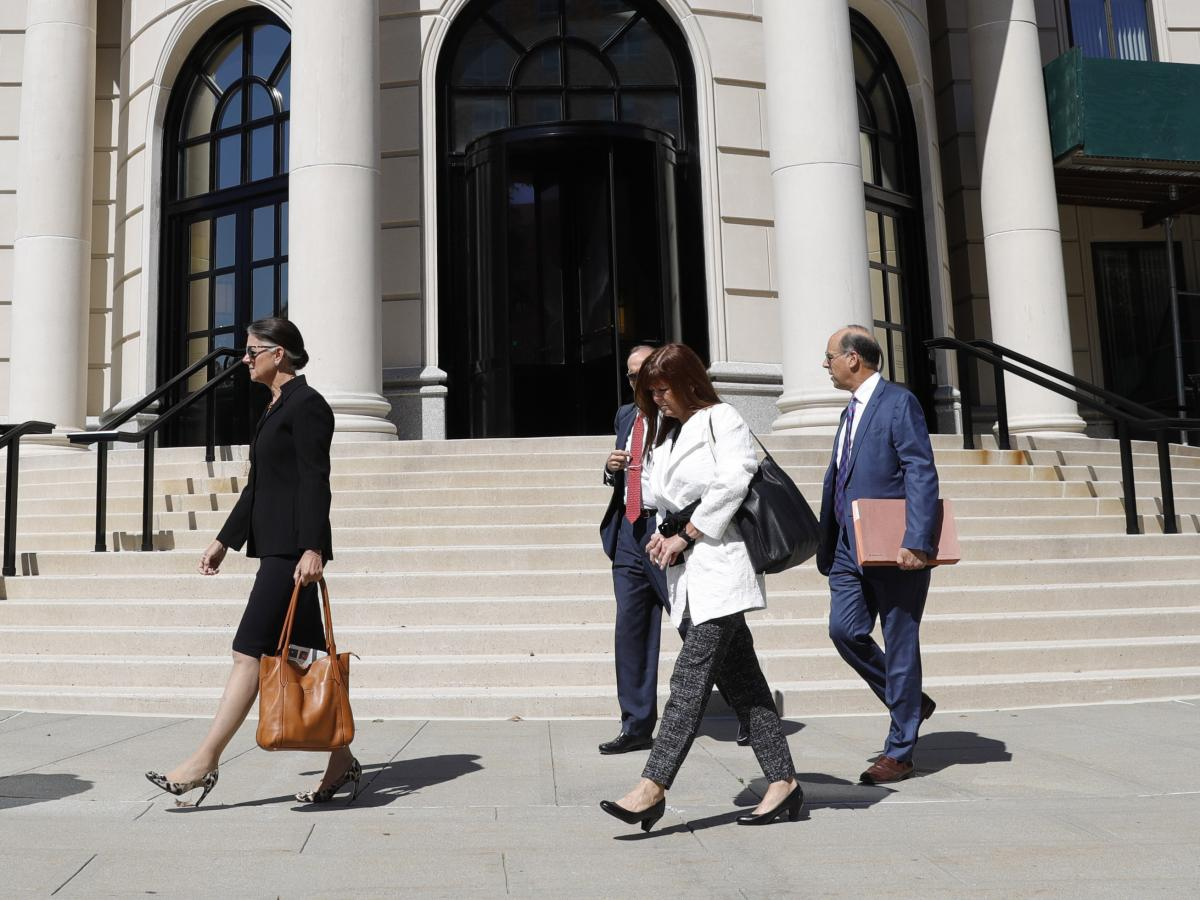 Attorneys and other people leave the U.S. District Court in September after Purdue Pharma's first hearing since filing for bankruptcy in White Plains, N.Y.