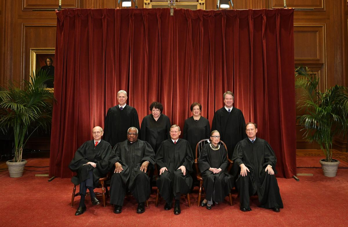Justices of the U.S. Supreme Court pose for their official photo at the Supreme Court in November 2018. Seated from left: Stephen Breyer, Clarence Thomas, Chief Justice John Roberts, Ruth Bader Ginsburg and Samuel Alito. Standing from left: Neil Gorsuch,