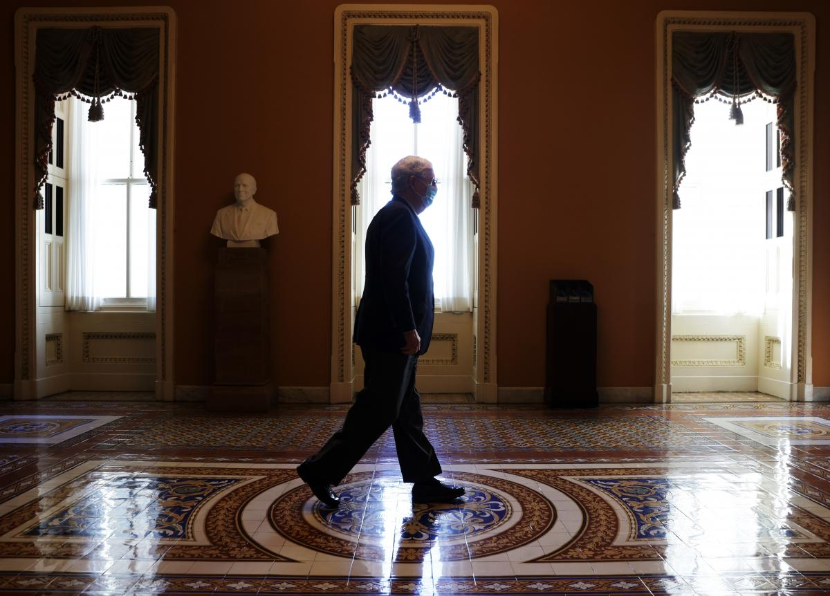 Senate Majority Leader Mitch McConnell, R-Ky., walks in a hallway at the Capitol on Monday. In a statement Ginsburg's passing, McConnell said President Trump's nominee for the bench will receive a vote in the Senate.