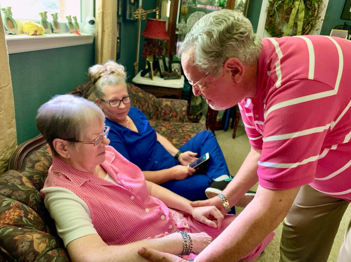 John McCasland (right) of Goodlettsville, Tenn., hired a private caregiver to help with his wife, Jean (left), who suffered from dementia for eight years. Even when hospice took over, he still found he needed the extra help from Karrie Velez (center). Jea