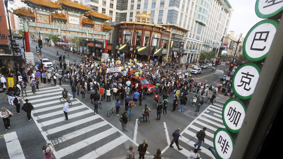 Protesters against police violence stop traffic at a major intersection Wednesday in Washington's Chinatown neighborhood as they begin a march toward the White House.