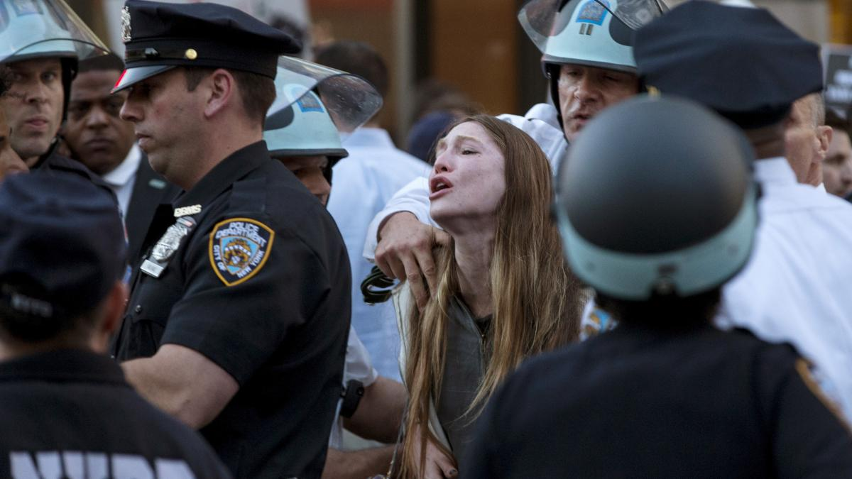 """A protester screams Wednesday as she is detained by New York police during a demonstration in the Manhattan borough of New York. Billed as """"NYC Rise Up & Shut it Down With Baltimore,"""" the demonstration was being held to support Baltimore's protests agains"""