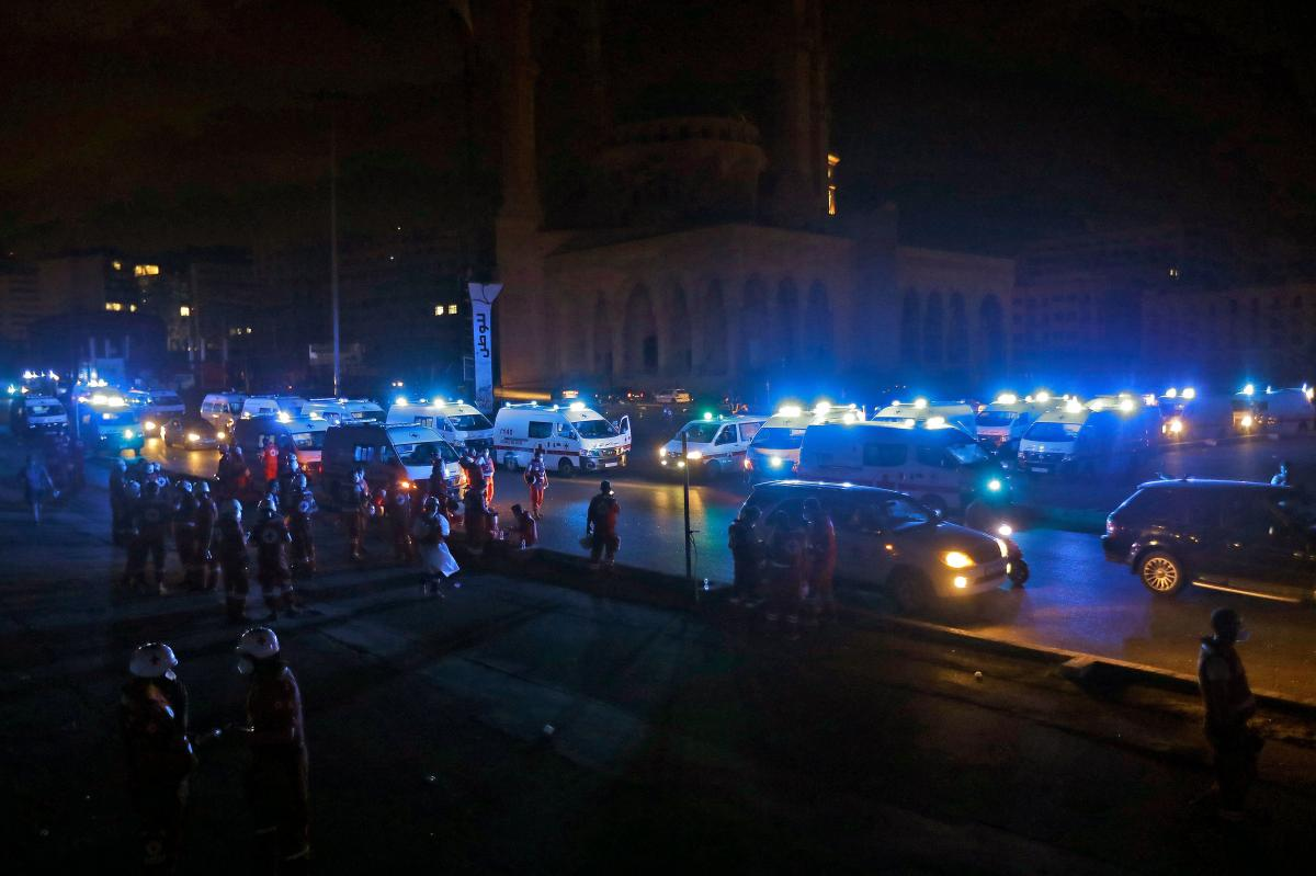 Lebanese Red Cross ambulances gather outside the Mohammad al-Amin Mosque in Beirut on Tuesday as they set up search-and-rescue operations for victims following the massive explosion.
