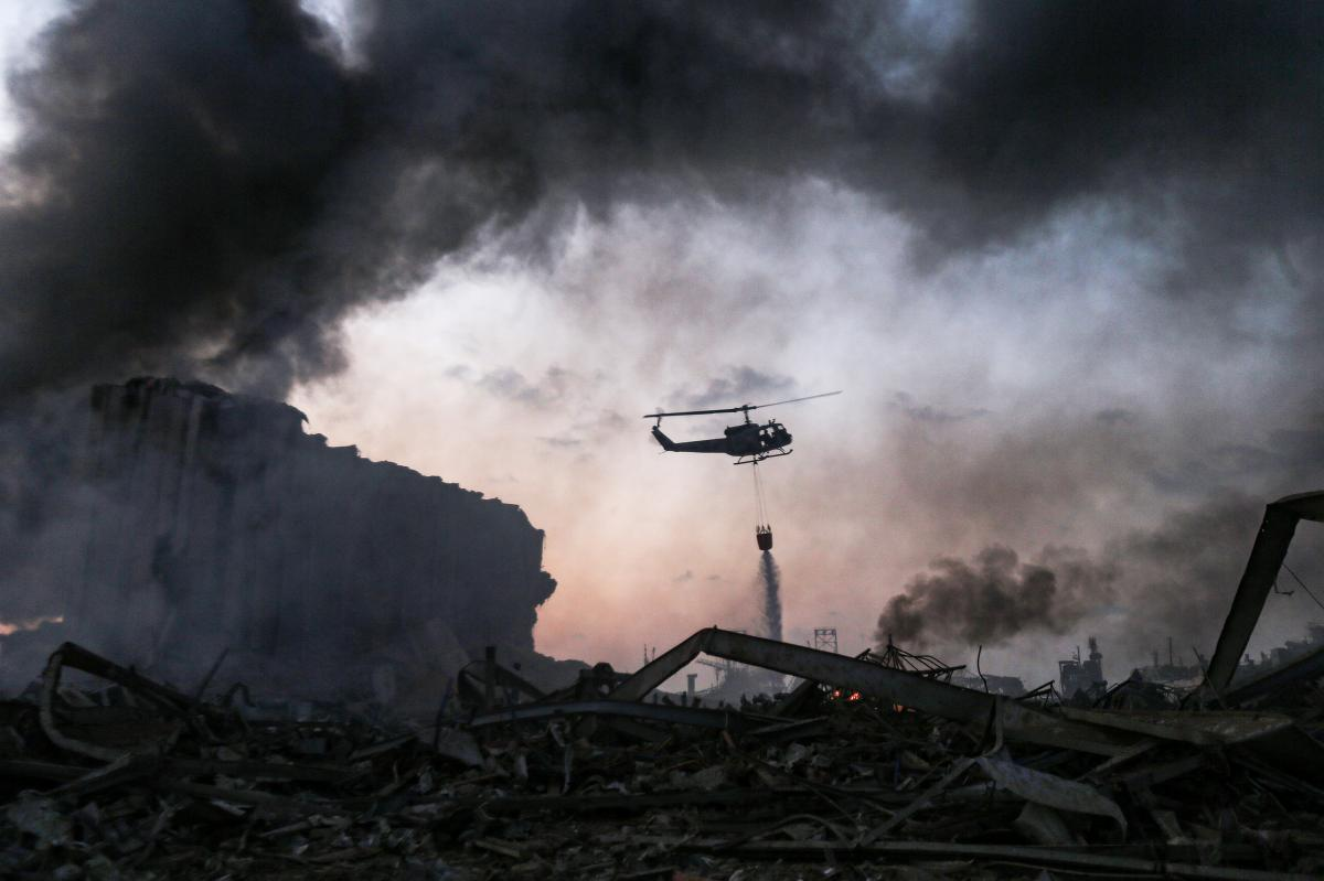A helicopter puts out a fire at the port in Beirut. Tuesday's explosion was felt miles away.