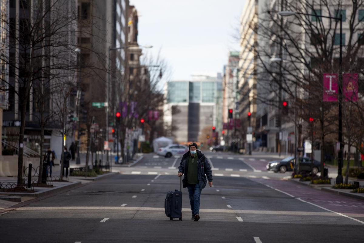 Views in downtown Washington, D.C. as Inauguration prep continues. A man walks down and empty I Street NW.
