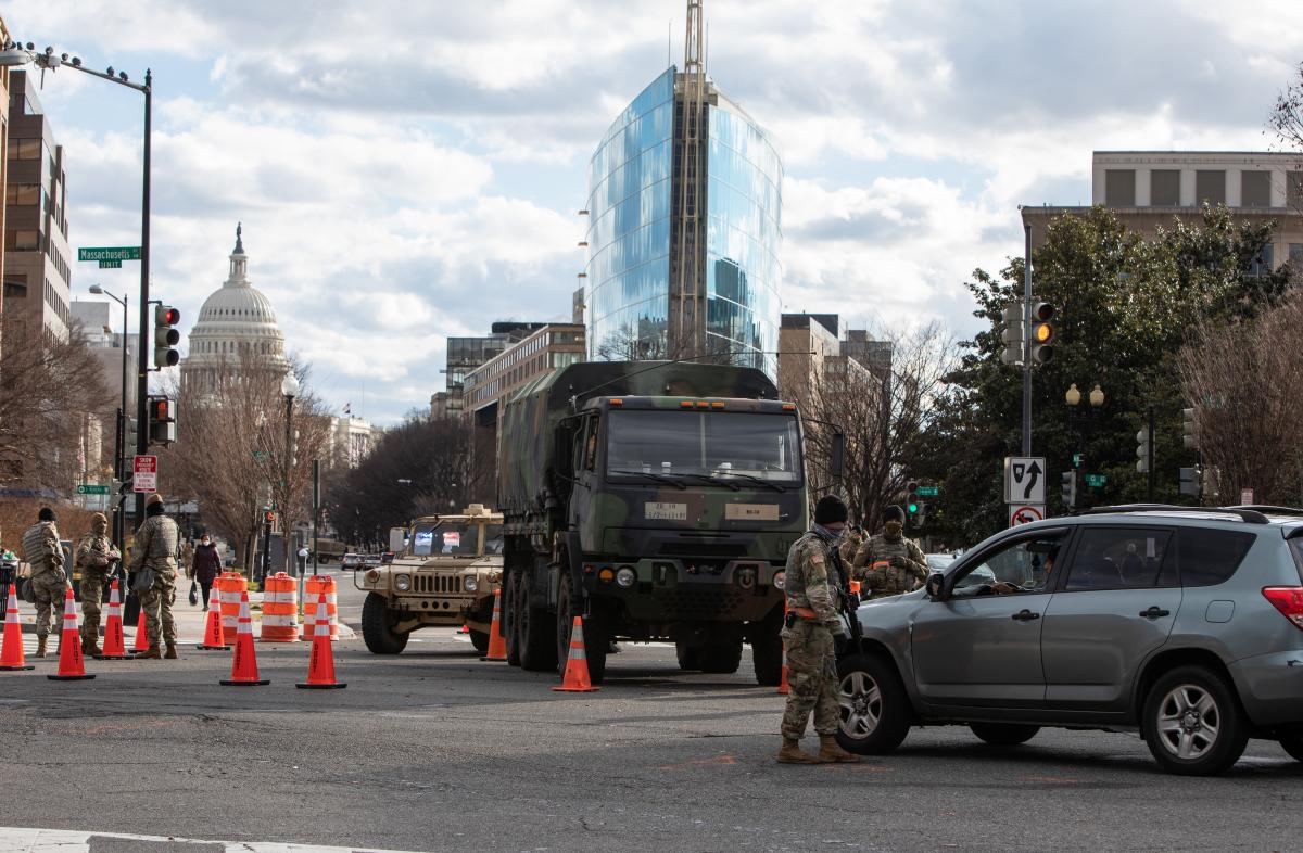 A member of the National Guard protects the perimeter fencing around the Capitol Hill.